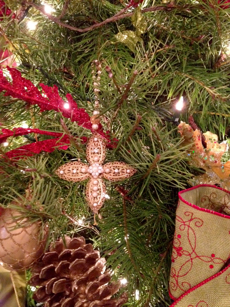 (One our favorite Christmas gifts each year are crosses that Dr. & Mrs. Ed Young give us. They decorate our tree and remind us of the real reason for the season.)